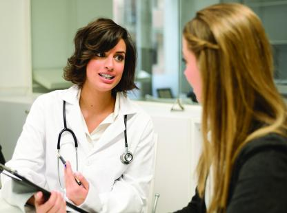 Photo of Doctor speaking with student