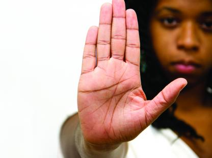 photo of a female student with her hand up